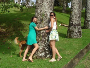 Image of 2 girls and dog photobombing