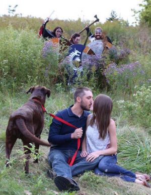 photo of kissing couple photobomb